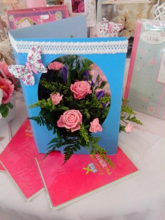 Fresh flowers in a greetings card. Four Seasons Florist Wigan 01942 523122